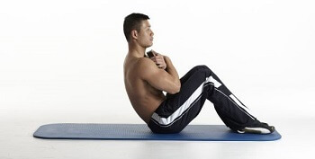 sit up with a weight plate