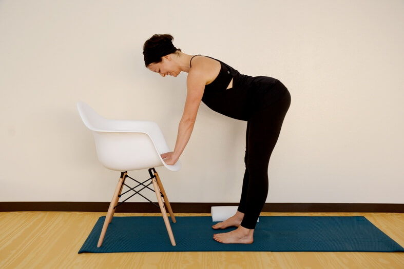 using chair to stretch arms